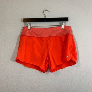 Nike dri fit orange running shorts